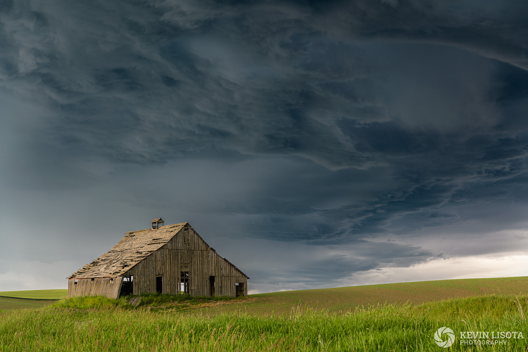 Old barn at Ladow Butte during a thunderstorm