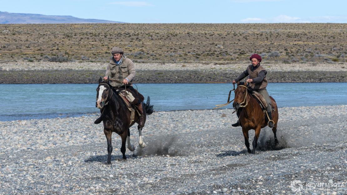 Gauchos on horseback along the La Leona River of Patagonia